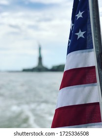 American Flag Close Up with Statue of Liberty in Background New York Circle Line Boat