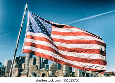 American flag covering Boston skyline, MA - USA.
