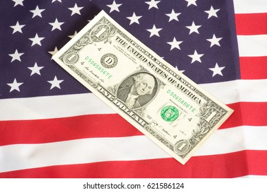American flag and dollar banknotes