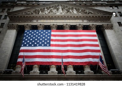 American flag draped over the exterior of the New York Stock Exchange with added vignette. 4th of July, 2018 - New York City, New York, USA.