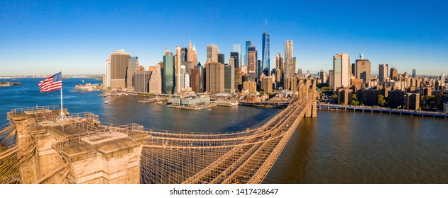 American flag during Independence Day over the Hudson River on Brooklyn Bridge with a view at Manhattan - New York City (NYC) - United States of America