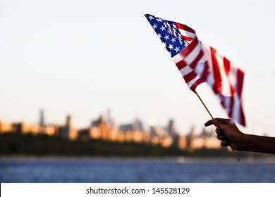 American flag during Independence Day on the Hudson River with a view at Manhattan - New York City (NYC) - United States of America