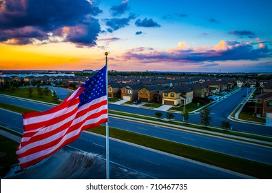 American Flag flying above Austin Texas Suburb with Homes and Houses in a row perfect America Iconic Suburbia American Homes Living in the USA