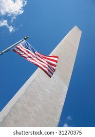 The American Flag flying in front of the Washington Monument.