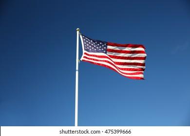An american flag flying on a flag pole