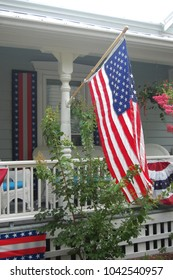 American flag flying on porch for July 4th festivities.