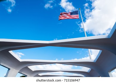 American flag flying over Arizona memorial