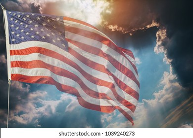 American flag flying, over beautiful Sunset sunrise with clouds,