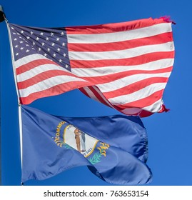 American flag flying in the wind with Kentucky flag