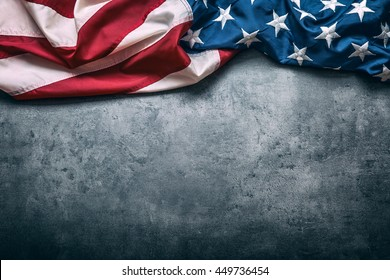 American flag freely lying on concrete board.