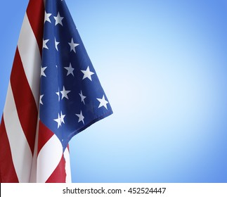 American flag in front of blue background