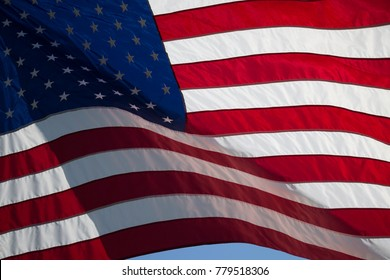 American Flag in front of the blue sky