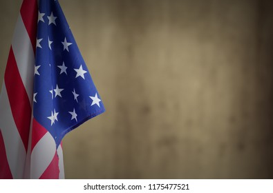 American flag in front of brown background. Copy space