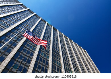 American flag in front of business building