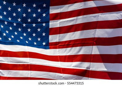 American flag in front of a city