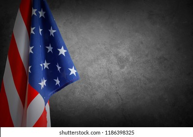 American flag in front of grey concrete