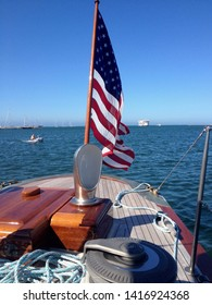 American flag at the front of a sail boat
