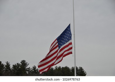 American Flag Half mast honor of students