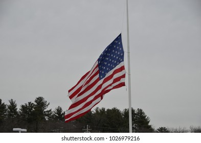 American Flag at half mast in honor of students shot in Florida