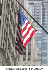 American flag handing from a building in New York City, USA