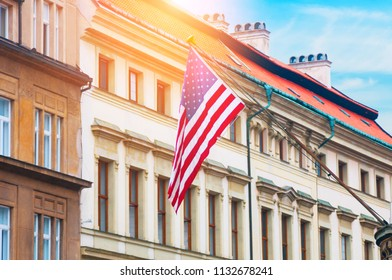 American flag hanging on a building