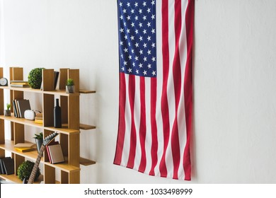 American flag hanging on wall inside living room