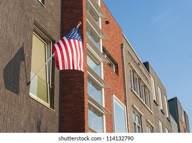 american flag hanging outside during July 4th in Enschede, Netherlands