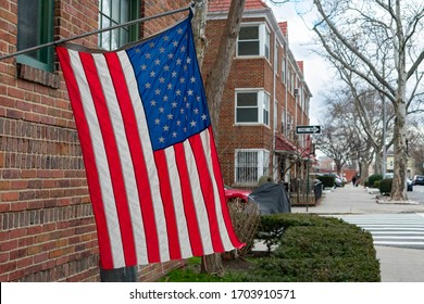 American Flag Hanging Outside of a Window of a Residential Building in Woodside Queens New York