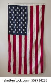 American Flag Hangs on Wall