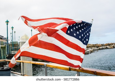 American Flag in a Harbor