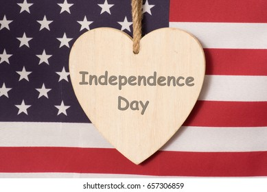 American flag and a heart with the imprint Independence Day