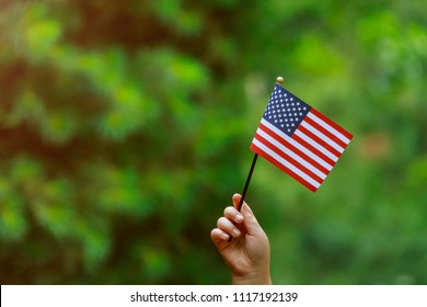 with american flag in her hand Independence Day, Flag Day concept