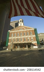 American Flag and historical Faneuil Hall from Revolutionary America in Boston, Massachusetts, New England