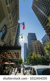 American flag illuminated and flanked by various forms of architecture on 4th Avenue, Downtown, Seattle, Washington, USA, North America 21 September 2017