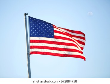American flag isolated in a blue sky