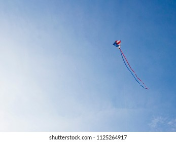 American Flag Kite Flying on a Blue Sky on the 4th of July