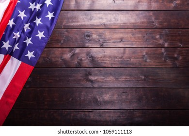 The American Flag Laying on a Rich Old Wooden Background