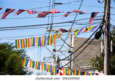 American flag and LBGT flags flying over Provincetown MA on Cape Cod