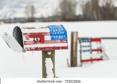 An American Flag mailbox is covered with snow after a winter storm.