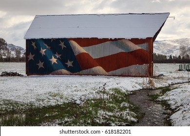 American flag mural on a wooden barn in rural Utah, USA.