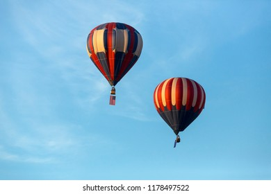 American flag and Nevada state flag flying with hot air balloons