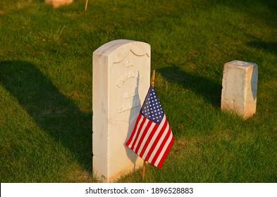 American Flag next to Unknown Soldier Veteran Grave Marker