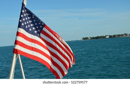 An american flag on the back of a boat in florida.