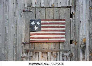 An american flag on a barn
