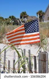 American flag on a beach fence