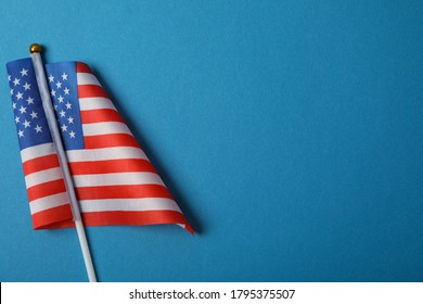 American flag on blue background, space for text