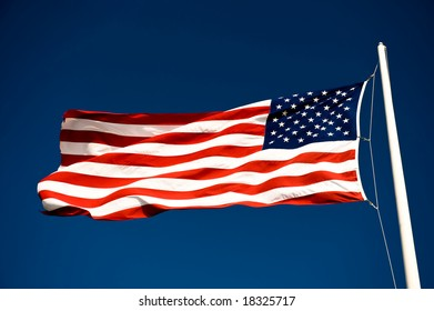 The American flag on the blue sky