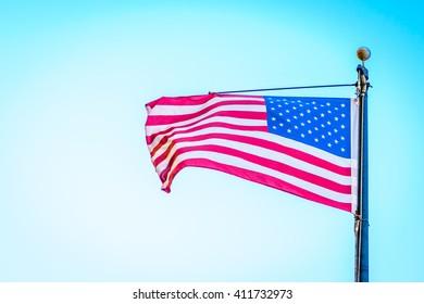 American flag on blue sky