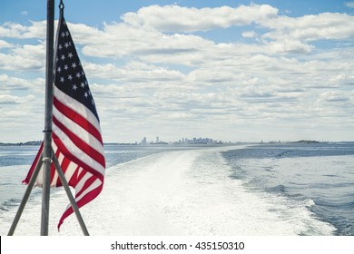 American flag on the boat leaving Boston harbor