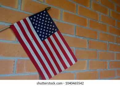 American flag on brick wall, god bless America, 4th of July concept